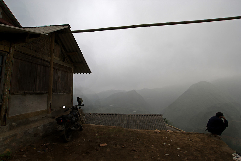 SAPA. MAN WITH A MOTOR BIKE IN THE FOG. VIET NAM.
