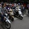HANOI. MOTORBIKES. TRAFFIC.