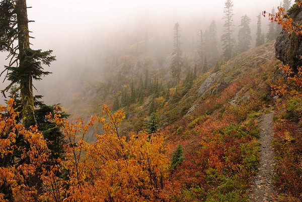 A trail hugs the mountainside above the Cle Elum River Valley