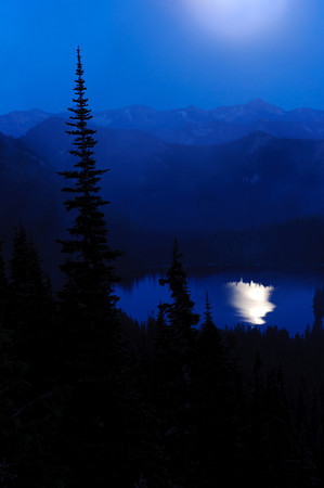 Moonlight reflection on a mountain lake