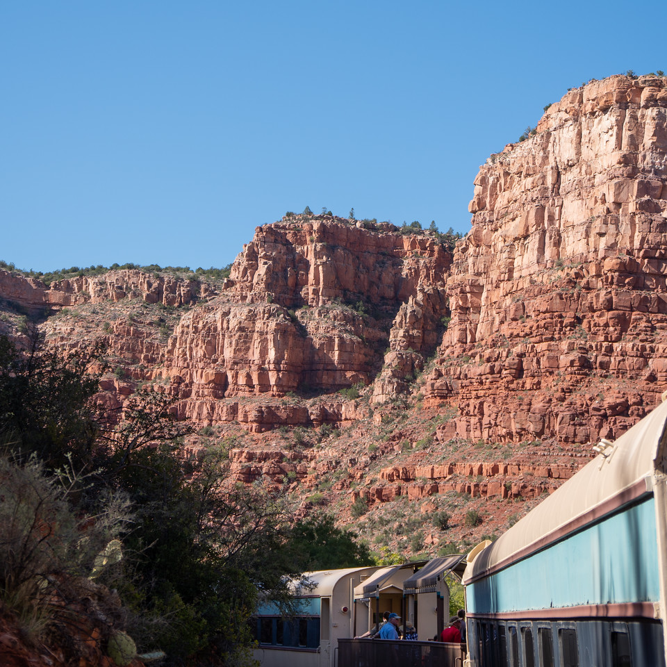 The train rounding a bend as the canyon takes shape above it.