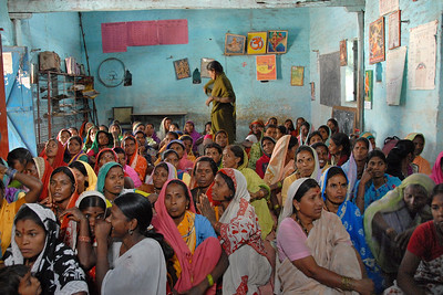 Meeting with the women from multiple villages when visiting them and an NGO on an international evaluation visit.
