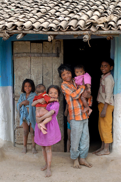 India: Children in a village near Nagpur, Maharashtra, India standing outside the home.