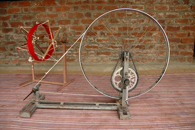 "Improvised bicycle used to make thread from cotton. Locally available cycle converted to this spinning machine called ""charkha"" which Mahatma Gandhi used to use."