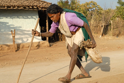 Old lady walking down the road in her village near Nagpur, Maharashtra, India.
