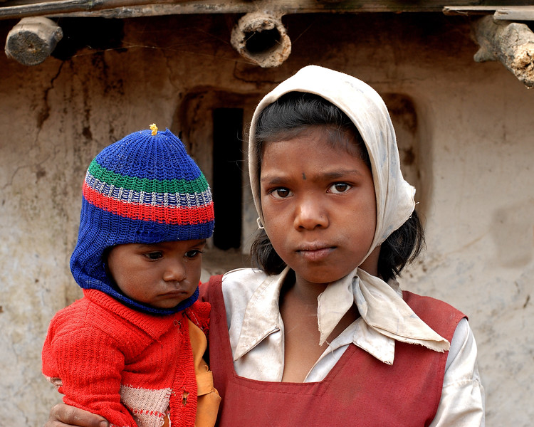 School girl with her brother in arms in rural Maharashtra.