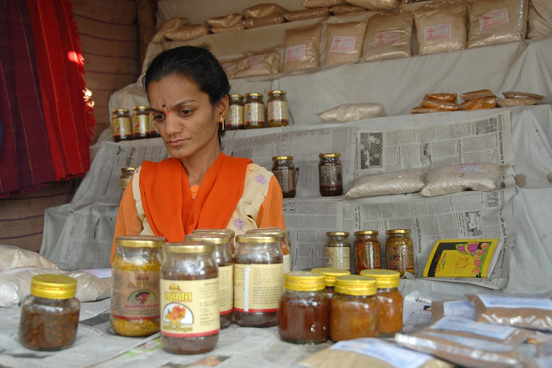 Lady with disabilities selling pickles at SIRDI made by WSHG (Womens Self Help Group). MH (Maharashtra), India.