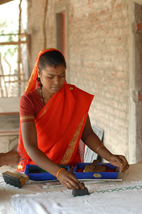 Locally village women doing block printing on the cloth they produce.