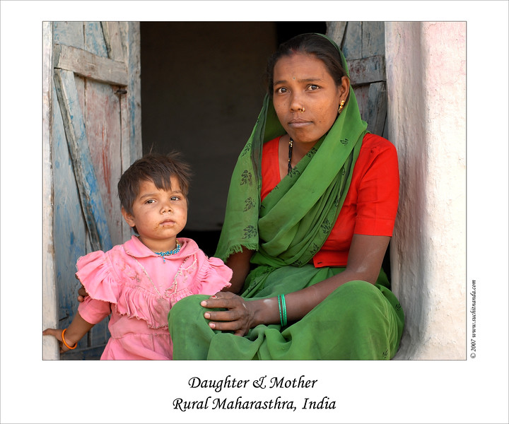 Mother & daughter at the entrance to their home in rural MH (Maharashtra), India.