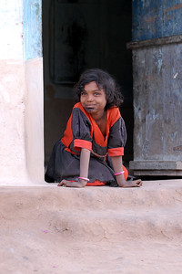 This girl child seen at the entrance of her rural home in a village near Nagpur, Maharasthra, India.
