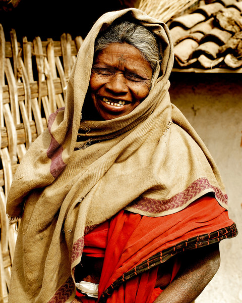 Elderly lady in front of her house located in a village near Nagpur, Maharashtra, India