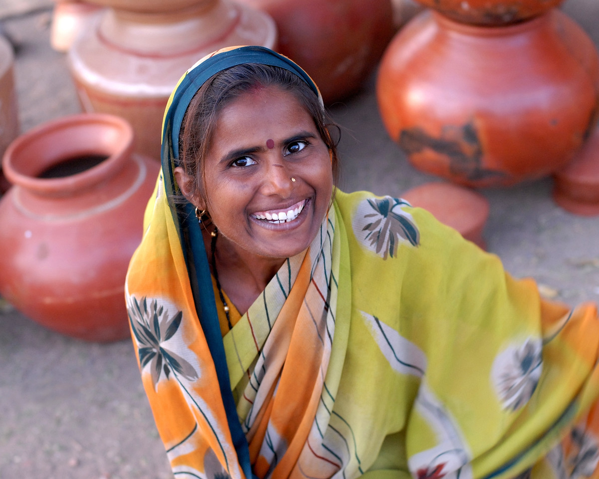 Lady selling pots at a village haat (market) in MH (Maharashtra), India.