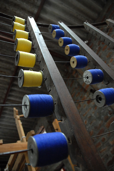 Spindles of threads used to make cloth from the locally grown cotton by village women.