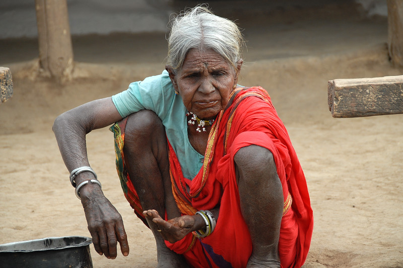 Old lady cleaning her teeth in MH, Maharashtra, India.
