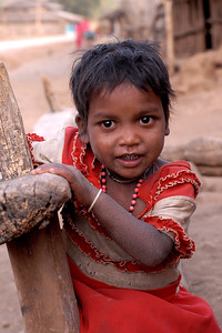 """The little bundle of joy"". Even with major dry skin all over, with her nose running and her cloths torn this little girl was full of energy and a bundle of joy. Probably seeing a camera for the first time she was shy yet curious. With water being a key resource, every effort is made to use minimum and to conserve it. Image shot near Nagpur, Maharashtra, India."
