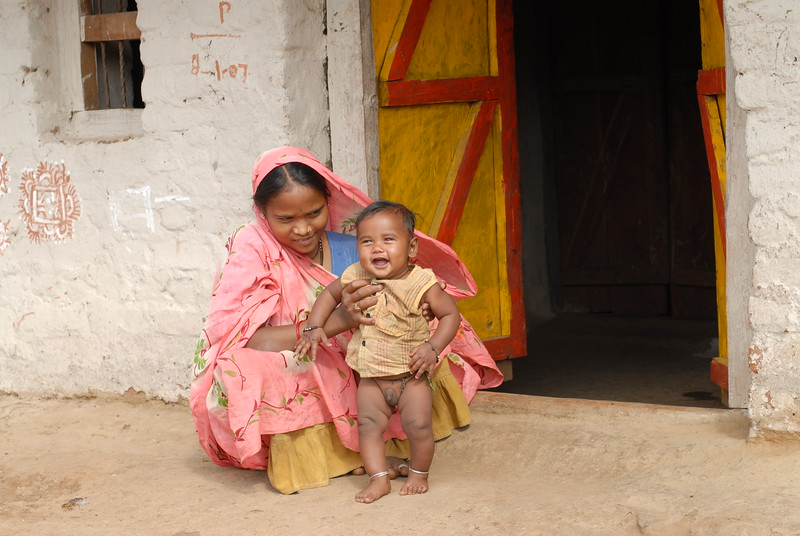Mother with her son in rural MP (Madhya Pradesh), India.