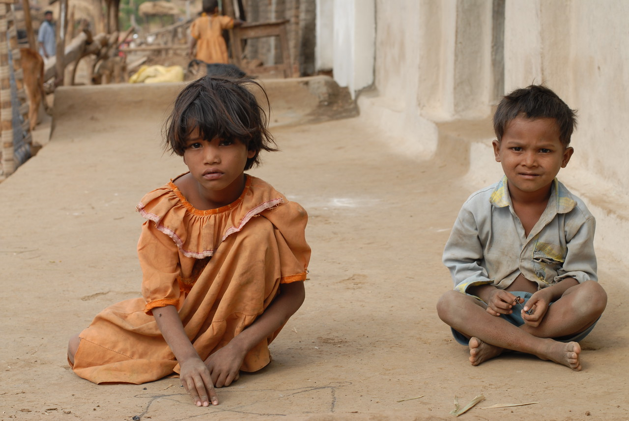 Children playing outside their home in a village in MH, Maharashtra, India.