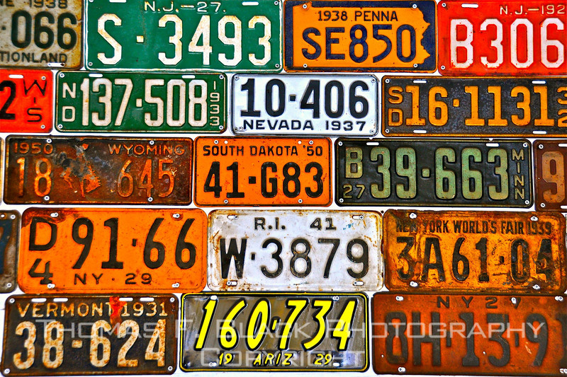 Old license plates mounted on interior wall of salvage yard shed, Calistoga, CA. [UFP030310]