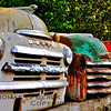 Front-end shells of 1940s and 1950s pickup trucks found in salvage yard, Calistoga, CA. [UFP030310]