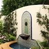 Mediterranean inspired wall fountain