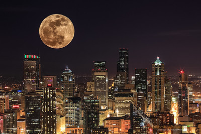 """Supermoon of May 2012"" Location: Two different locations... photos merged.  The supermoon of May 2012 was greeted with many enthusiastic photographers who took excellent pictures of the superbright, supersized moon against famous landmarks.  For me, going to remote location was out of questions, so I simply hoped to see the rising moon outside my home. Fortunately I had the view of the moon as it was rising up at the horizon. I made a few shots and decided to blend it with one of my older images shot at Seattle.  This image of Seattle skyline is one of my favorites. I shot it from top of space needle on a clear night. The sharpness of the lines, light on the buildings and clarity was in favor of the image, but I always felt that a moon in the sky would have been nice.  So I finally saw the opportunity to combine these two images. I usually don't combine images, but this one came out nice... hence posting it.  Tech Info: Lens: Canon EF 70-200 f/4L IS at 85mm for skyline, 200mm for the moon Camera: Canon EOS 5D Mk II Exposure: 120sec at f/16 and ISO 50 for the skyline, 0.3sec at f/13 and ISO 100 for the moon. Filters: No filters  Post Processing: Images combined in PhotoShop CS6."