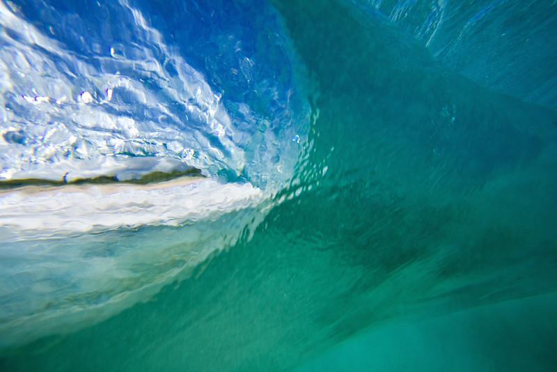 Behind a crashing wave.