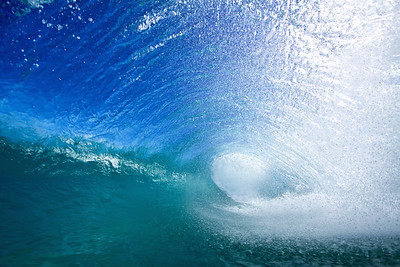 Backwash hitting a falling lip will create a large round barrel.