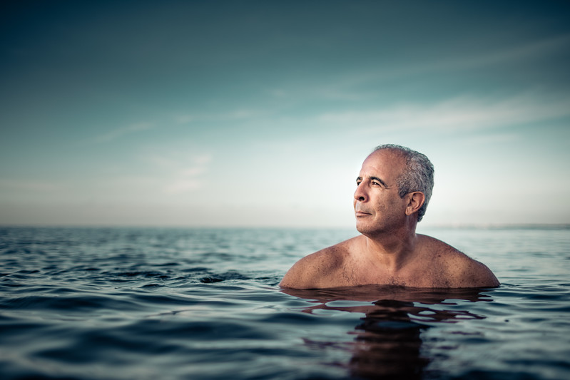 A  peaceful man floating in the water