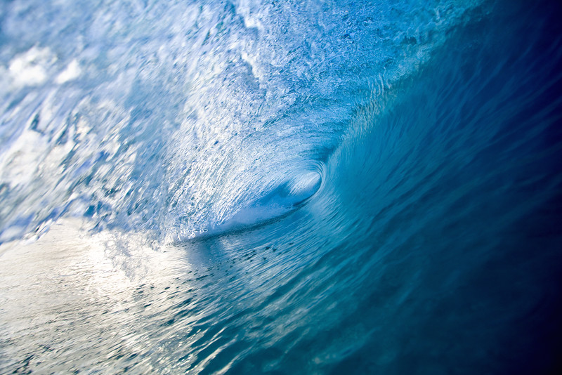 Evening light brought out the deep blues in this wave.
