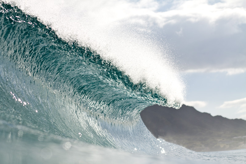 Shooting into the sun can yield breathtaking images of a crashing wave.