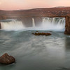 <H3> Majesty of Godafoss </H3> One of the most famous of Icelands waterfalls is Godafoss (Waterfall of the Gods). It was named after the event in the year 1000 when the law speaker of the Alþing declared Iceland a Christian nation and threw down his pagan carvings of Norse gods in this river. This evening, the soft twilight colors and the moonrise brought about a fantastic scene to witness