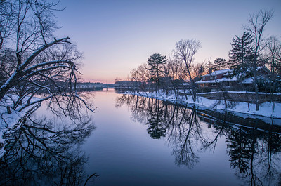 """Snowy River""  The sun sets on the Wisconsin River in Wisconsin Rapids, Wisconsin."