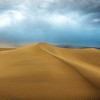 A wind storm nears its end across the Mesquite Sand Dunes in Death Valley National Park, revealing pristine shaped sand dunes in it's wake.
