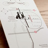 Pictured: Custom map with illustrations<br /> <br /> Black pocket fold invitation - including four inserts: custom map, RSVP postcard, accommodation information, and rehearsal dinner invitation and map. Bound with a soft blush satin ribbon. Printed on heavy, cream card stock.