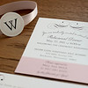 Pictured: Rehearsal dinner invitation and belly-band detail.<br /> <br /> Black pocket fold invitation - including four inserts: custom map, RSVP postcard, accommodation information, and rehearsal dinner invitation and map.  Bound with a soft blush satin ribbon.  Printed on heavy, cream card stock.