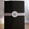 Black pocket fold invitation with soft blush satin ribbon belly-band
