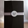 Black pocket fold invitation with soft blush satin ribbon belly-band