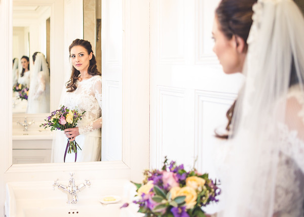 Stunning creative portrait of bride in mirrors