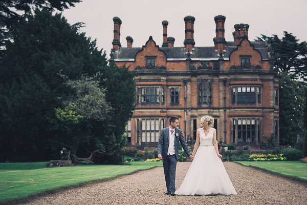 Bride and groom Walking down the Path outside Beaumanor hall