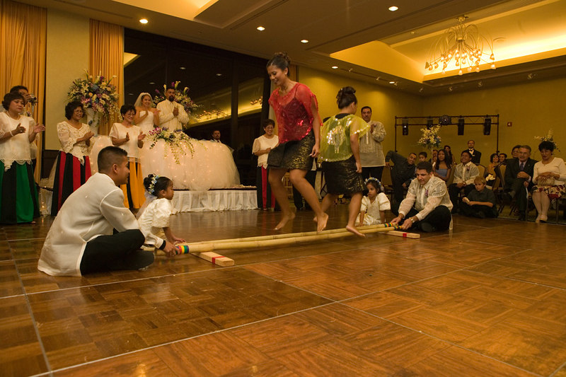 Performing Tinikling, a traditional Philippine dance