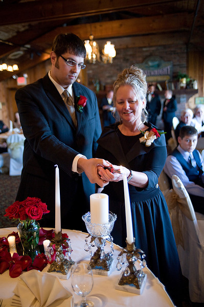 Bride's mother & escort light the unity candle