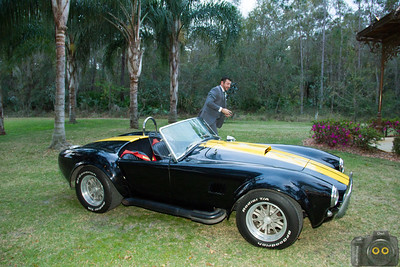 Wedding Photo of the Groom arriving at the ceremony in a Cobra.