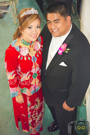 Wedding Photo of Bride and Groom with the Bride in Chinese style dress.