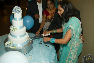 Wedding Photo of the Bride and Groom cutting their Wedding Cake.