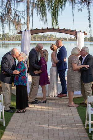 Wedding Photo of the Newlyweds, Parents, and Grandparents.