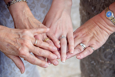 Wedding Photo of the Bride, Bride's Mother, and Grandmothers' rings.