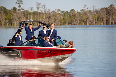 Wedding Photo of the Groom and Groomsmen making an entrance in a speed boat.