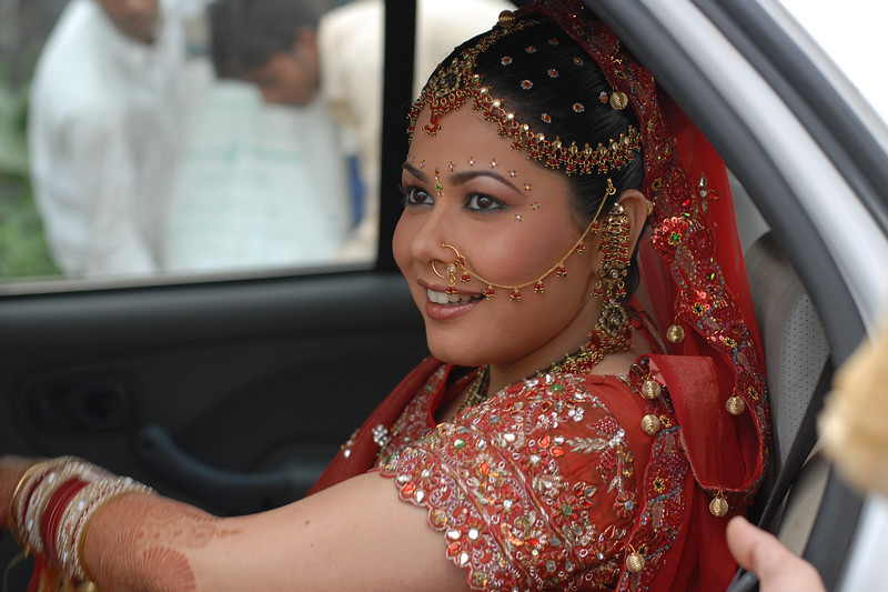 Priya Seth getting out of the car at the venue. Priya Seth and Sumit Dargad's wedding in Mumbai (Bombay), Maharashtra, India. December 2007.