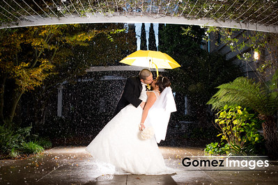 Wedding kiss under the rain at Biltmore Hotel in Santa clara