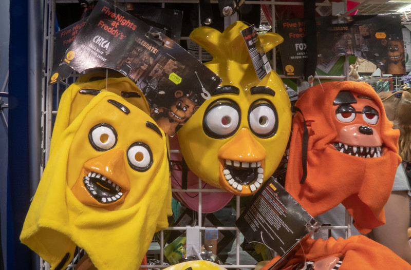 Silly masks on display at a toyseller's booth, WonderCon 2019